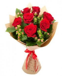 Bouquet of red roses in kraft papper