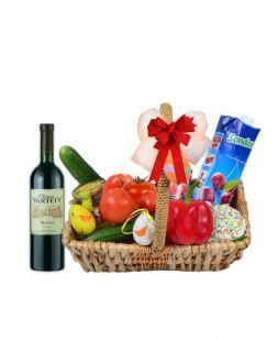 Easter basket with wine and vegetables