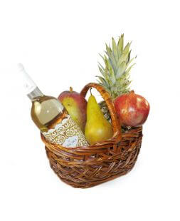 basket with fruits and white wine