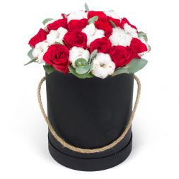 roses with cotton in a box