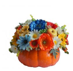 artificial flowers in a pumpkin