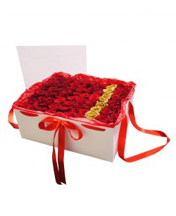 box with red and golden roses