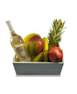 basket with wine and fruits