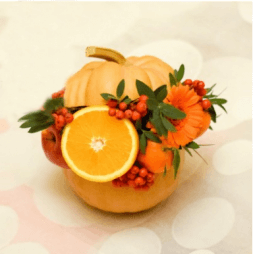 bouquet of fruit and flower in a pumpkin