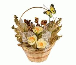basket with fresh flowers and chocolates