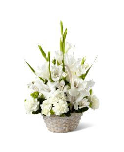 Basket with gladioluses, carnations and alstroemerias