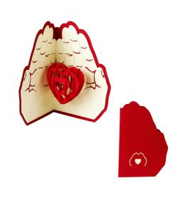 card in the shape of heart in the palms